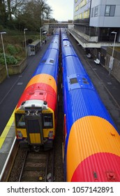 Bracknell, England - March 29, 2018: An above view of two trains operated by the South Western Railway company waiting to depart from the platform at Bracknell Railway Station in England