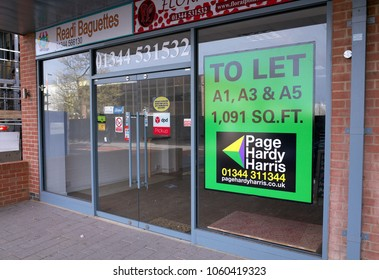 Bracknell, England - March 29, 2018: To Let Real Estate Agent sign in the window of an empty retail store in Bracknell, England