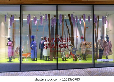 Bracknell, England - May 30, 2018: Formal Summer fashion clothing for the Royal Ascot Racing Week in the window display of Fenwick department store in Bracknell, England