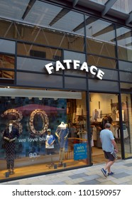 Bracknell, England - May 30, 2018: A pedestrian passes by the Fat Face clothing store in Bracknell, England. Fat Face is a lifestyle clothing and accessories retailer based in the UK
