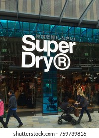 Bracknell, England - Nov 21, 2017: People passing by the Superdry clothing store in Bracknell, England. Superdry is part of Supergroup PLC, a British clothing company