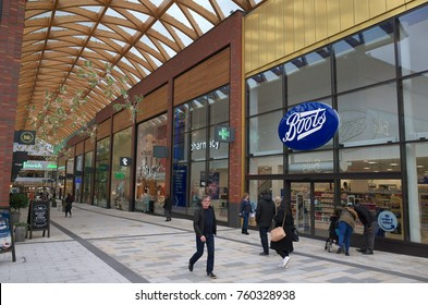 Bracknell, England - Nov 22, 2017: People passing by the Boots store in the Lexicon shopping center, opened in 2017 as part of the ongoing redevelopment of Bracknell Town in England
