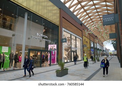 Bracknell, England - Nov 22, 2017: People passing by various retail stores in the Lexicon shopping center, opened in 2017 as part of the ongoing redevelopment of Bracknell Town in England