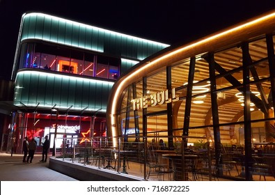 BRACKNELL, UK - 17 SEPTEMBER 2017: The Bull Public House and Cineworld in Bracknell's regenerated town centre, known as The Lexicon. Night time.