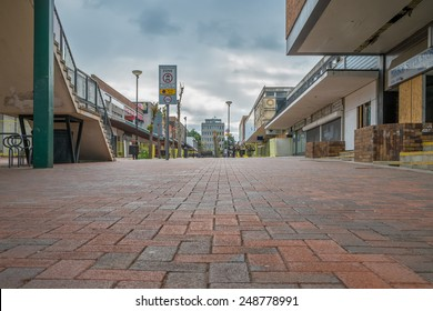 BRACKNELL, UK - AUGUST 11, 2013: An empty high street in the Berkshire town of Bracknell. Awaiting demolition to make way for re-development.