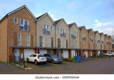 Bracknell,England - January 22, 2018: Row of modern Town Houses with Garages underneath and cars parked out front in Bracknell, England