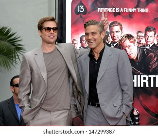 Brad Pitt and George Clooney at the Handprint & Footprint Ceremony For Ocean's Thirteen's George Clooney, Brad Pitt, Matt Damon, and Jerry Weintraub Gruman's Chinese Theater Los Angeles, CA June 5, 2007
