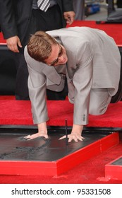 """Brad Pitt at hand & footprint ceremony at Grauman's Chinese Theatre for the stars of """"Ocean's Thirteen."""" June 5, 2007  Los Angeles, CA Picture: Paul Smith / Featureflash"""
