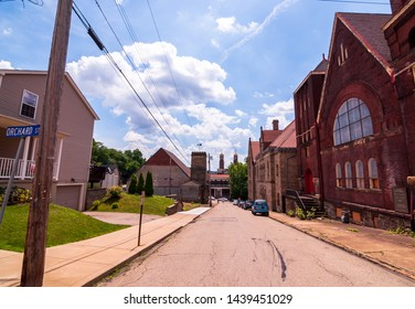 Braddock, Pennsylvania, USA 6/29/2019 A view of Parker Avenue looking towards Library Street on a bright sunny day