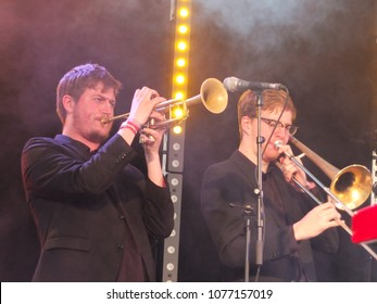 Bradford, England - July 29 2017: brass section of the band Ska Vengers performing on stage at bradford festival