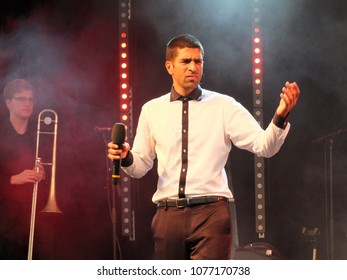 Bradford, England - July 29 2017: Delhi Sultanate the singer from the band Ska Vengers performing on stage at bradford festival