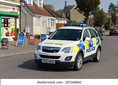BRADFORD ON AVON - APR 21: A police car responds to an emergency on Apr 21, 2015 in Bradford on Avon, UK. Bradford on Avon is policed by the Wiltshire Constabulary covering 1346 square miles.
