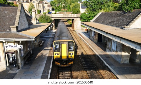 BRADFORD ON AVON - AUG 15: A train departs the town station on Aug 15, 2010 in Bradford on Avon, UK. Opened in 1825 the rail system of the UK is the world's oldest, currently with 15,800 km of lines.
