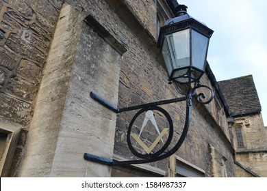 Bradford on Avon - January 21, 2017: A Masonic symbol is seen at a lodge on a town street. Freemasons opened the first Grand Lodge in London circa 1700, and Freemasonry has since spread worldwide.