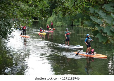 Bradford on Avon, UK - August 3, 2018: People paddleboard up the River Avon.