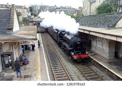 Bradford on Avon, UK - December 4, 2018: The steam engine Cathedrals Express pass through Bradford on Avon railway station.