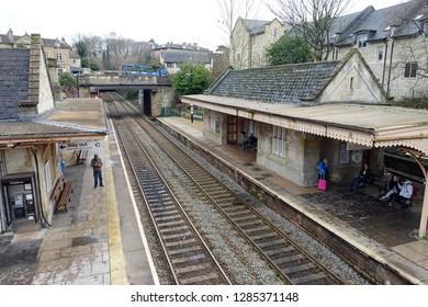 Bradford on Avon, UK - December 4, 2018: People wait for trains at Bradford on Avon railway station.