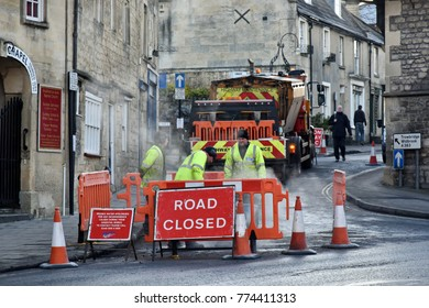 Bradford on Avon, UK - December 12, 2017: Road workers repair a road surface at a roadworks in the town centre.