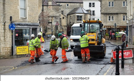 Bradford on Avon, UK - March 12, 2018: Road workers repair a road surface at a roadworks in the town centre. The Department of Transport has advised thousands of UK roads are in a poor condition.