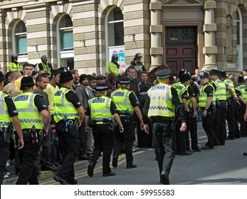 BRADFORD, WEST YORKSHIRE, ENGLAND-AUG 28: Riot Police fight to control demonstrators of the EDL (English Defence League) and Islamic protesters on August 28, 2010 in Bradford, West Yorkshire