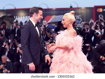 Bradley Cooper (L) and Lady Gaga walk the red carpet ahead of the 'A Star Is Born' screening during the 75th Venice Film Festival at Sala Grande on August 31, 2018 in Venice, Italy.