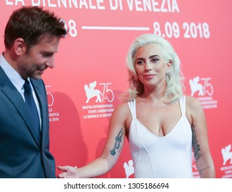 Bradley Cooper and Lady Gaga attend 'A Star Is Born' photocall during the 75th Venice Film Festival at Sala Casino on August 31, 2018 in Venice, Italy.