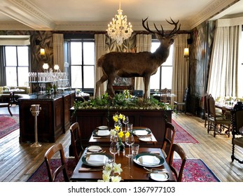 BRAEMAR, SCOTLAND - APRIL 12, 2019: Inside The Clunie dining room at The Fife Arms Hotel in Braemar, Aberdeenshire, UK.