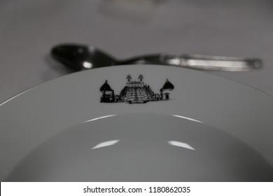 Braga, Bom Jesus, Minho area, Europe / Portugal - June 6, 2018: Restaurante Central do Bom Jesus,white ceramic plate with restaurant logo and spoon on the table
