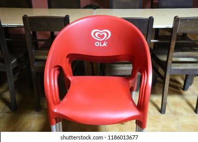 """Braga, Bom Jesus, Minho area, Europe / Portugal - June 6, 2018: Restaurante Central do Bom Jesus,red plastic chair with the logo of the firm """"Ola"""""""