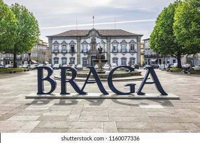 BRAGA, PORTUGAL - APRIL 17, 2017: Praca do Municipio (Municipality Square) in Braga downtown. On Praca do Municipio is the city Hall, Pelicano's Fountain and famous Braga Sign or logo of city Braga.