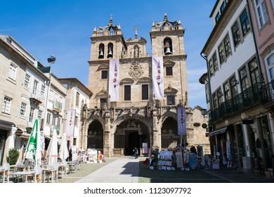 BRAGA, PORTUGAL - CIRCA APRIL 2017: Unidentified people walk past the Braga Cathedral