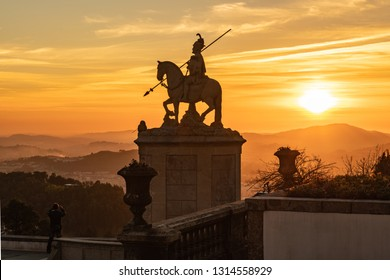 BRAGA, PORTUGAL - CIRCA FEBRUARY 2019: Sunset silhouette of sculpture of St Longinus in famous sanctuary Bom Jesus do Monte near Braga city in historical Minho Province, Portugal.