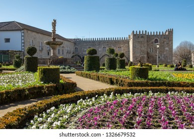 BRAGA, PORTUGAL - CIRCA FEBRUARY 2019: Santa Barbara garden with the medieval Episcopal Palace of Braga in background.