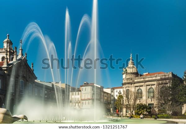 BRAGA, PORTUGAL - CIRCA FEBRUARY 2019: Fountains at Medieval Republic Square or Praca da Republica known as Arcade. Braga urban cityscape, one of the oldest cities of Portugal.