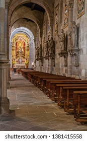 Braga, Portugal - December 28, 2017: Se de Braga Cathedral interior. Aisle and chapel. Oldest Cathedral in Portugal. 11th century Romanesque with Gothic and Baroque adding