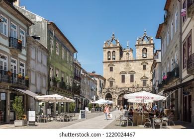 BRAGA, PORTUGAL - JULY 8, 2015: Main façade of Braga Cathedral, Braga, Portugal, as seen from Rua Dom Paio Mendes . The cathedral is known as Sé de Braga in Portuguese.