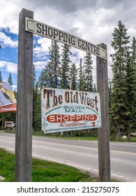 BRAGG CREEK, CANADA - SEPT 4: Old rustic sign for the Old West Shopping Mall on September 4, 2014 in Bragg Creek, Alberta, Canada. The Old West Shopping Mall is a tourist attraction in Bragg Creek.