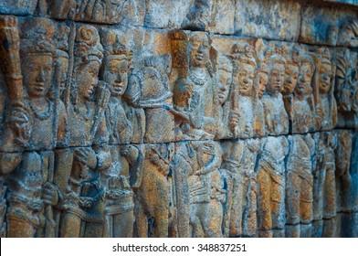Brahman Buddha  stone Carvings at Borobudur temple on the bricks in Indonesia