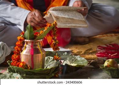 Brahman reading hindu mantra in Bardia, Nepal - Shutterstock ID 243400606
