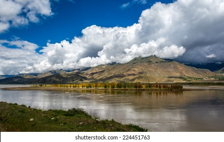 The Brahmaputra river with cloudy sky in Tibet.