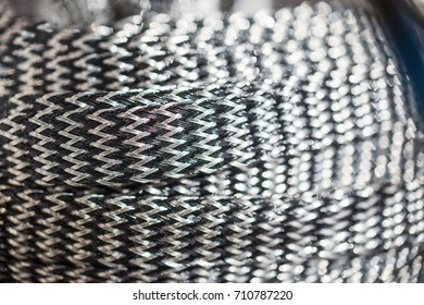 The braid from composite wires is ultra-light shielding. Electrotechnical products.