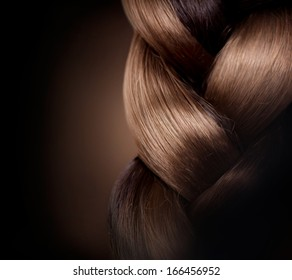 Braid Hairstyle. Brown Long Hair close up. Healthy Hair