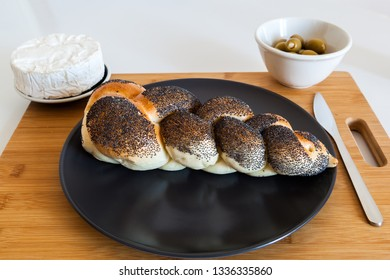 Braided bread with olives and soft cheese