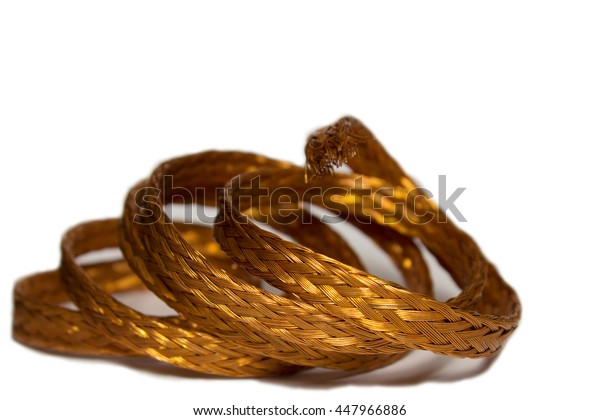 Braided copper wire  twisted ring on a white background with space for text.
