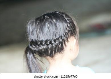 Braided hair on asian child  head