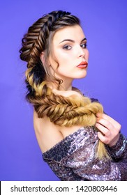 Braided hairstyle. Beautiful young woman with modern hairstyle. Beauty salon hairdresser art. Girl makeup face braided long hair. French braid. Professional hair care and creating hairstyle.