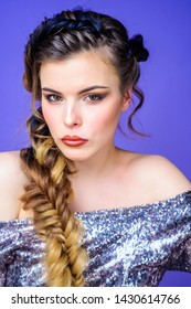Braided hairstyle. Beautiful young woman with modern hairstyle. Girl makeup face braided long hair. French braid. Professional hair care and creating hairstyle. Beauty salon hairdresser art.