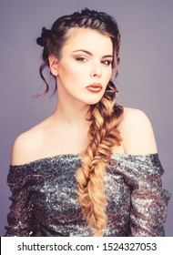 Braided hairstyle. French braid. Professional hair care and creating hairstyle. Beauty salon hairdresser art. Beautiful young woman with modern hairstyle. Girl makeup face braided long hair.