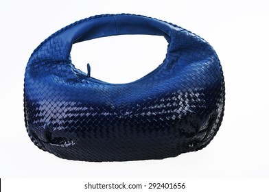 Braided leather blue bag isolated on white background