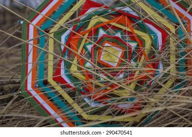 braided mandala on the grass